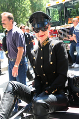 Smiling Woman in Uniform (shaire productions) Tags: street portrait people urban woman smile smiling fashion lady female photo sitting image candid photograph sit metropolis seated fashionable informal