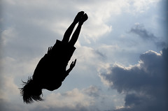 Trampolining in Tennoji (ahtevis) Tags: sky girl weather silhouette japan clouds japanese cloudy trampoline osaka partly tennoji trampolining