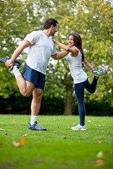 Woman and her sports trainer (Activate Fitness) Tags: people woman man male guy sports girl loss smile smiling sport female train training outdoors happy person athletic healthy couple slim exercise body young lifestyle stretch thin cheerful workout fitness adults stretching weight tracksuit trainer fit partners determination sportswear bodycare sportive exercising