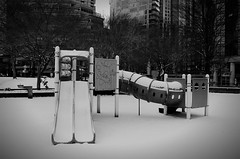 Snowcouver 2012. (papertrailsandtales) Tags: winter snow canada cold playground kids vancouver blackwhite play slide swing coalharbor downtownvancouver firstwinter winter2012