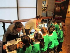 A school group visits our conservation table