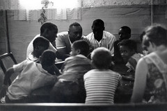 A group of students and tutors sits around a table at Freedom House's Roxbury Work Study Project Tutorial (conman1190) Tags: usa boston ma mass communitydevelopment africanamericanchildren africanamericanstudentsmassachusettsboston africanamericanseducationmassachusettsboston urbanmassachusettsboston racerelationsmassachusettsboston freedomhouseroxbury roxburyworkstudyproject