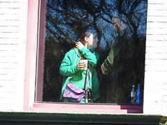 They were watching a parade in a tavern, cheers! (kennethkonica) Tags: people usa reflection green window glass america canon midwest random candid indianapolis indy indiana drinks tavern persons global canonpowershot hoosier marioncounty ccouple