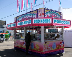 Popcorn/Sno Cones/Cotton Candy Trailer. (dccradio) Tags: carnival shadow sky building festival wisconsin fence fun outdoors pavement flag bluesky fair flags tent canvas powerlines event entertainment popcorn cottoncandy portage midway wi stmaryschurch amusements clearsky caramelapples electriclines communityevent fairfood utilitylines dizzydragons foodtrailer foodtrailers foodconcessions ridefence christmanamusements stmarysbestfest