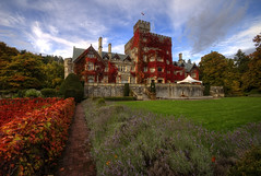 Hatley Castle Fall Colors (Brandon Godfrey) Tags: blue autumn trees red sky canada green castle fall colors grass architecture clouds colorful day colours cloudy britishcolumbia victoria vancouverisland colourful hdr royalroadsuniversity hatleycastle ruleofthirds colwood 2011 tonemapped xmencastle scotishbaronialstyle smallvillecastle lexluthorsmansion xaviersshcoolforgiftedyoungsters