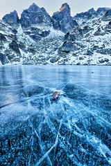 Cracks In the Ice (Evgeni Dinev) Tags: mountain lake ice vertical bulgaria cracks   rilamountain
