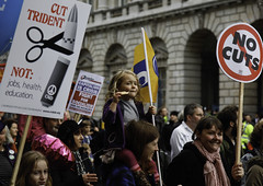 Little Striker Girl (Sven Loach) Tags: uk november girls england london public 30 canon walking demo march women dof britain eating budget flag families protest smiles photojournalism nov30 99 sector posters strike 5d unions colourful capitalism cuts crisis protesters n30 socialism placards reportage markii trident strikers londonist 2011 pensions austerity 30nov