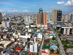 Aerial Shot of Makati City (GreenArcher04) Tags: world city sky urban house building eye birds skyline modern clouds skyscraper canon river bay asia cityscape view metro cloudy south philippines aerial powershot east rainy manila cebu third housing shanty boracay makati residential condominium davao quezon s90 palawan roxas squatter pasig marikina mandaluyong