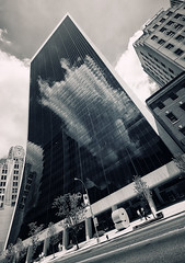 Trapped Reflection (Philipp Klinger Photography) Tags: street new york city nyc newyorkcity travel windows vacation sky people urban bw sculpture woman cloud white holiday ny newyork man black reflection building tree window glass girl architecture clouds facade skyscraper reflections blackwhite nikon angle manhattan nine wide entrance 9 midtown highrise lantern curve curved philipp ultra sigma1224mm hochhaus klinger ultrawideangle d700