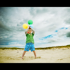 Back in the Holiday Mood (PMMPhoto) Tags: uk blue boy sky green beach yellow clouds balloons fun happy scotland nikon nikkor tiree