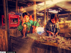 Girls Preparing Fish at Food Market in Battambang Cambodia (Captain Kimo) Tags: girls food sun fish cambodia cambodian khmer market working rays highdynamicrange battambang foodmarket lightray chldren photomatix hdrphotography hdrphotos hdrimages captainkimo hdrsoftwarereview