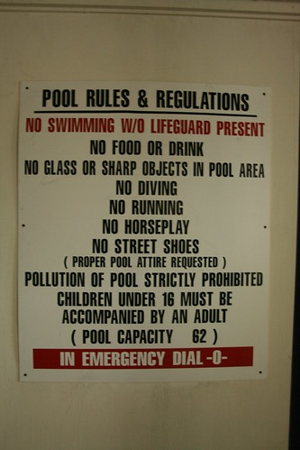 Pool rules and regulations sign