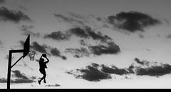 He got game II (ssj_george) Tags: christmas leica sunset bw white man black sports monochrome silhouette basketball clouds lens lumix person jump day basket action board cyprus 360 panasonic jam nba dmc lockout dunk larnaca larnaka kypros tz3 kipros κύπροσ georgestavrinos λάρνακα ssjgeorge γιώργοσσταυρινόσ giorgosstavrinos giwrgosstavrinos