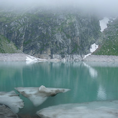 The melt of glaciers in the Hohen Tauern (Bn) Tags: park blue summer mist mountain holiday snow man ski alps ice rock misty fog clouds bench walking geotagged hope austria frozen wooden high topf50 sitting random hiking altitude low year trails peak panoramic glacier suddenly thoughts alpine national journey experience thinking dreams leisure descend mountainside stool staring stroll topf100 better thick fascinating hohe slopes phenomenon offpiste bankje stausee uttendorf gletsjer tauern 100faves 50faves rudolfshtte weissee panview tauernmoossee 2315m geo:lon=12618613 geo:lat=47127235 granatspitz