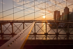 NYC Sunset from the Brooklyn Bridge (jrobblee) Tags: nyc bridge sunset sun ny newyork colour water statue brooklyn clouds sunrise canon landscape liberty eos golden pattern cityscape wideangle beam wires lensflare brooklynbridge flare jersey sunburst burst newyorknewyork starburst christmasday sunflare waterscape statueliberty 50d canoneos50d canon50d beginnerdigitalphotographychallengewinner