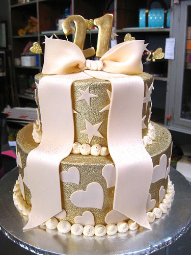 2 Tier Wicked Chocolate Cake Iced In Gold Butter Icing Decorated