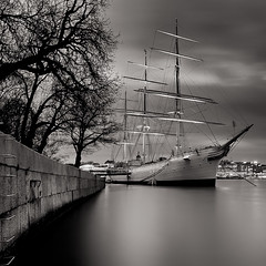 Smooth Sailing Into the Harbor Of Dreams (Night version).. (Peter Levi) Tags: longexposure sea sky blackandwhite bw blancoynegro water clouds harbor ship sweden stockholm le afchapman blackwhitephotos travellingclouds bestcapturesaoi elitegalleryaoi ringexcellence dblringexcellence tplringexcellence eltringexcellence