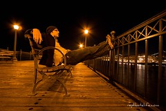 A Man and a Pier (YBowyer Photography) Tags: ocean sanfrancisco wood man water hat ferry night bench relax lights pier boat dock san francisco alone natural streetlamp rail naturallight single embarcadero relaxed solitary woodenpier embarcaderopier