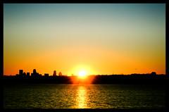 There is one glory for the sun. (svllcn) Tags: blue light sunset orange sun lake dallas nikon d5100