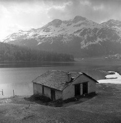 054459 06 (ndpa / s. lundeen, archivist) Tags: blackandwhite bw house mountain lake mountains alps building 6x6 tlr film home clouds mediumformat switzerland town blackwhite europe village swiss nick may peak alpine 1950s peaks engadin 1959 snowcovered stmoritz municipality dewolf triptoeurope sanktmoritz coveredinsnow nickdewolf photographbynickdewolf engadinvalley