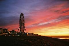 early morning wheel (lomokev) Tags: morning pink sea sky orange cloud beach silhouette sunrise brighton fuji mju superia olympus 400 ferriswheel bigwheel fujisuperia fujisuperia400 cliché xtra fujicolor olympusmju olympusmjuii fujicolorsuperia400 deletetag fujicolorsuperia olympusmju2 brightonwheel brightono file:name=120119olympusmjuiisuperia40031 file:name=120119olympusmjuiisuperia400