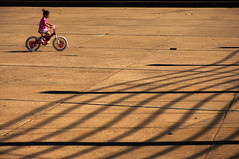 Girl on Bike (District of Colombia) Tags: southamerica girl bike bicycle uruguay shadows montevideo nikond90