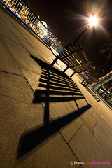 London - Lonely Chair . . . (Beauty Eye) Tags: park city uk longexposure bridge sea london eye tower thames architecture night canon river dark landscape eos rebel lights europe long exposure nightshot unitedkingdom britain outdoor great gb tamron westminister t3i europen ultrawideangle   f3545  600d    leurope   beautyeye 1024mm  canon600d eneurope  tamronspaf1024mmf3545diiild rebelt3i diiild canon600deos tamronspaf1024mmf3545d