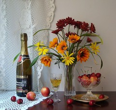 Prelude to a Birthday. (Esther Spektor - Thanks for 8 millions views..) Tags: art explore stilllife naturemorte creative naturezamorta artistic bodegon naturamorta artisticphotos birthday prelude vase flowers bouquet bottle champagne goblet crystal plate stand table fruits food cherry apple curtain lace petals leaves chrysanthemum light reflection green red yellow orange white brown glass lable artofimages bej coth artdigital estherspektor creativephoto esther stem daisy golden brass