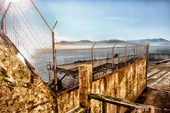 Inside Alcatraz:  Recreation Yard (SergeK ) Tags: life sanfrancisco california family food usa water wearing work ball bread bay clothing san escape shot unitedstates labor hard bad daily chain medical rights alcatraz recreation shelter behavior visits federal restricted harsh activities californie penitentiary punishments prisoners recreational confinement attempts sergek lockdowns