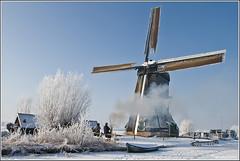 -12º Celcius in Kinderdijk (Wim Boon Fotografie) Tags: winter cold holland ice netherlands windmill fire 7d kinderdijk landschap koud canon1740f4l alblasserdam winterlicht wipmolen wimzilver