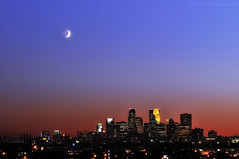 Crescent moon over Minneapolis (jpnuwat) Tags: city moon minnesota skyline night twilight dusk minneapolis crescent gradnd dsc7685