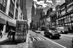 34th St (Brandon Godfrey) Tags: newyorkcity newyork nyc thebigapple 34th bw manhattan midtown midtownmanhattan empirestatebuilding esb garmentdistrict usa unitedstatesofamerica unitedstates northamerica urban cityscape bigcity newsstand city architecture street streetphotography