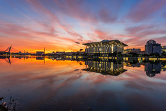 Glory Morning (HakiimMislam) Tags: city sky urban sun lake reflection water sunrise canon landscape rising outdoor dusk sony wideangle malaysia putrajaya hdr