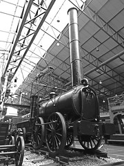 1829 Steam Locomotive ' AGENORIA'. (ManOfYorkshire) Tags: 1829 agenoria nrm locomotive old steam design inefficient shuttend colliery staffordshire freight coal wagons canal pit history national railway museum york yorkshire blackwhite highcontrast sony camera monochrome angle black chimney beams rods pistons boiler stephensons rocket