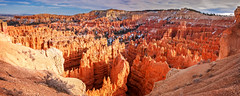 Bryce Canyon Panorama (danielacon15) Tags: travel red panorama orange usa snow nature beautiful crimson landscape utah nationalpark colorful afternoon erosion depression late bryce geology brycecanyon patches hoodoos amphiteather