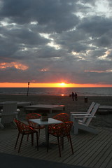 Sunset at the beach (birgit dottir) Tags: sunset sky orange beach chair translucent thehague beachclub kijkduin spectacularsunsetsandsunrises beachclubpeople