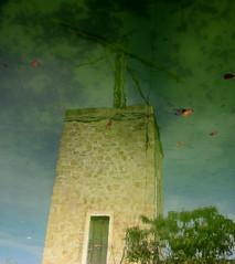 Millpond (Tom in Ibiza) Tags: espaa water reflections spain europe mediterranean experimental windmills 2011 flickrstruereflection1 irrigationibiza