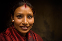 Welcome to Kathmandu by Michael Anderson (AndersonImages) Tags: nepal red portrait woman face scarf eyes kathmandu hindu patan
