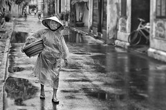 Rainy Morning in Hoi An (Pete_Latham) Tags: street old portrait woman lens effects vietnam hoian topaz niksoftware