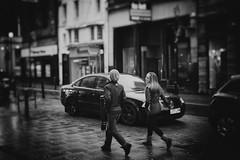 Rain Romance (stephen cosh) Tags: life street leica city people blackandwhite bw sepia youth mono scotland town unitedkingdom candid streetphotography rangefinder ayr reallife ayrshire humancondition blackandwhitephotos 50mmsummilux blackwhitephotos leicam9 stephencosh