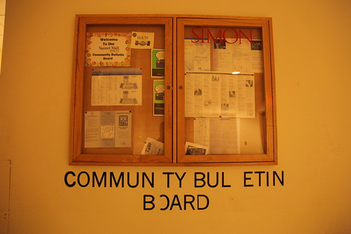 Community bulletin board filled with expired info