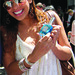 Amber Stevens  is holding Cali Blue perfume by AromaEarth.com
