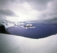 crater lake, winter wardrobe (manyfires) Tags: blue winter lake snow cold square landscape island stormy pinhole craterlake zero2000 wizardisland zeroimage craterlakenationalpark