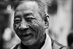 Young at heart. (A. adnan) Tags: guangzhou china old portrait bw man monochrome smile smiling nikon chinese wrinkles zhongshan nikon50mmf14d skinlesion d7000