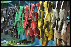 hanging (h a t h i w a l a) Tags: new red white black green leather yellow festival shop retail shoe nikon sale cream shore footware hanging colourful f56 oman hang muscat sandal 115 d90 chappal premal hathiwala qurum mojdi 1102030990
