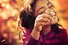 let it be sunshine (Proleshi) Tags: light flower smile smiling 50mm warm glow dof shine bright bokeh stripes joy saturday happiness delight flowergirl bliss glimmer josephs jamal glee d300s proleshi