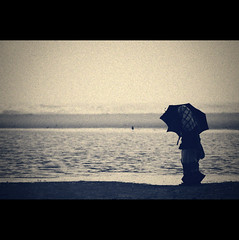 Loneliness | Explored (VinothChandar) Tags: india beach rain analog marina umbrella photoshop canon photography photo alone loneliness photos weekend walk 5d lonely grains marinabeach chennai solitary processed tamilnadu chennaimarinabeach