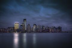 World Trade Center (Tim Drivas) Tags: newyorkcity newyork skyline night reflections downtown skyscrapers cloudy manhattan worldtradecenter hudsonriver wtc gothamist hdr financialcenter lowermanhattan freedomtower 1worldtradecenter