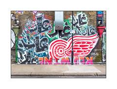Graffiti (Cave, AMQ, Edwin), East London, England. (Joseph O'Malley64) Tags: uk greatbritain england streetart london tarmac wall concrete graffiti paint britain murals spray lamppost british cave walls cans redwine aerosol edwin brickwork eastend eastlondon brickedupwindows cowling drainpipes detroitredwings permitparking wallmurals muralists granitekerbing amq