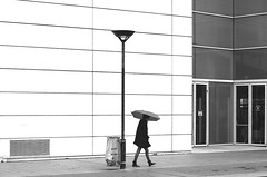 By passing behind the streetlight (pascalcolin1) Tags: blackandwhite woman rain umbrella noiretblanc femme pluie streetview parapluie paris13 photoderue urbanarte photopascalcolin